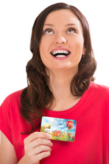 Extremely positive woman holding bank plastic credit or debit ca
