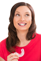 Closeup portrait of charming woman wearing orthodontic braces