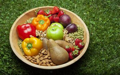 Healthy foods in bowl, paleo diet foods, fruits nuts and berries