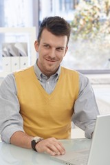 Happy businessman working at desk