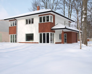 Modern mansion covered with snow