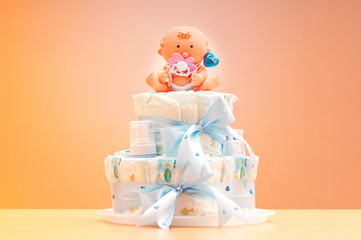 Cakes made of diapers on white