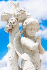 Infant angel with a blue sky background