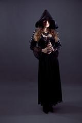 Young women in black long dress