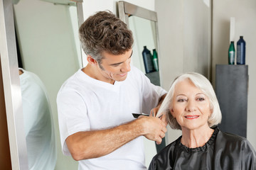 Client Getting Haircut By Hairstylist