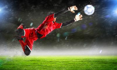 Spoed Fotobehang Voetbal Goalkeeper catches the ball