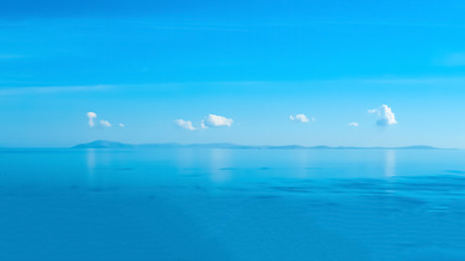 Wall Mural - Isolated Clouds above Santorini island Greece rare sky view from