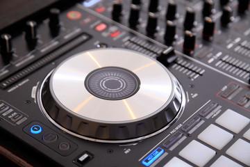 Closeup of dj controller with jog wheel