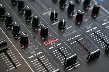 Closeup of audio mixer with selective focus
