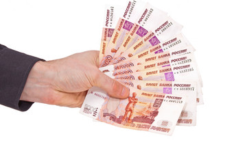Russian rubles banknotes in a man's hand