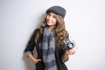 Young woman with retro film camera.