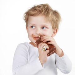 Cute little boy with chocolate