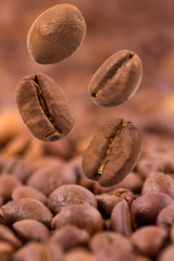 Closeup of coffee beans flying selective focus