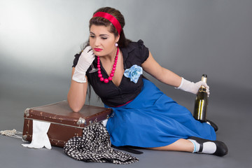 drunk pinup girl with bottle of champagne