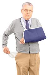 Poor man with broken arm showing his empty pocket
