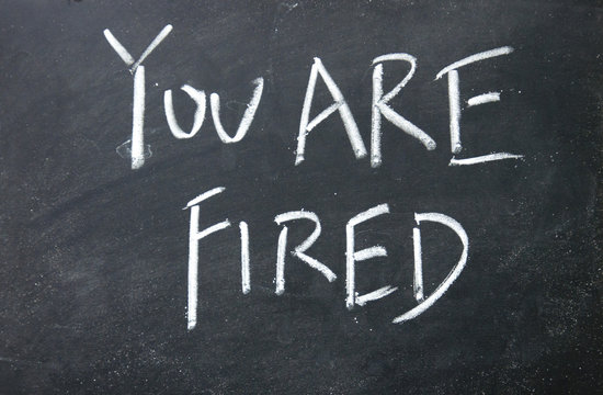 you are fired title written with chalk on blackboard