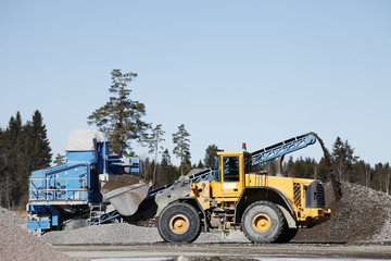 heavy truck working inside gravel and sand industry