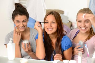 Three teenager girls getting ready in bathroom