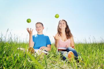 Summer portrait, children with apples