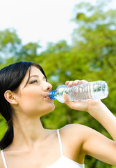 Portrait of woman drinking water outdoor