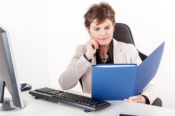 Businesswoman examination of documents