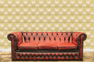 Retro styled image of an old sofa against a vintage wall