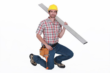 Carpenter against  carrying steel post