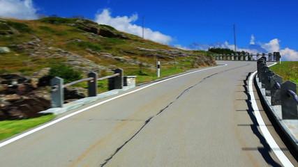Fototapete - Road travel in Alps.