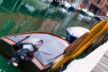 Boats parked in a street of Murano