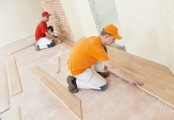 Obraz parquet workers at flooring work - fototapety do salonu