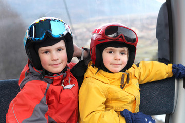 Two happy boys in cable car