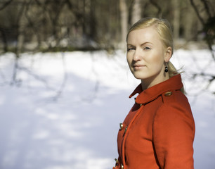 Woman in red coat with firmly look