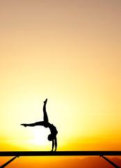 Fototapete - handstand on balance beam