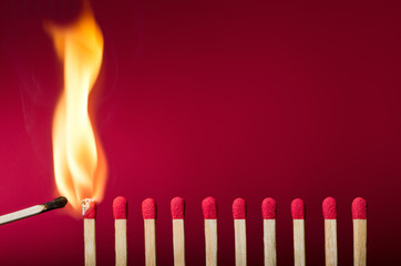 Burning match setting fire to its neighbors