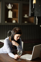 Woman on a laptop in kitchen