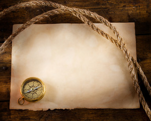 Fototapete - old compass and rope on vintage paper