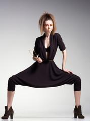 sexy woman model in large pants - studio fashion shot