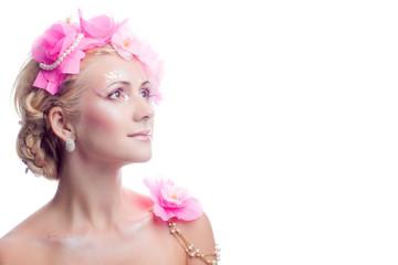 A beautiful spring girl wearing flowers. Studio shot.