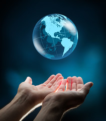 Wall Mural - blue world in hands