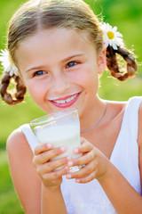 Health, diet - lovely girl drinking fresh milk outdoors