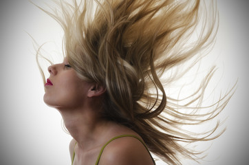 woman with hair flying in the air
