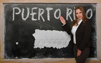 Teacher showing map of puerto rico on blackboard