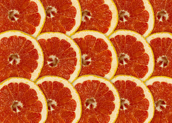 Tuinposter Plakjes fruit Abstract red background with citrus-fruit of grapefruit slices