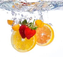 Fototapeta Fruit falling into water