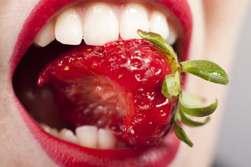 Strawberry in the mouth