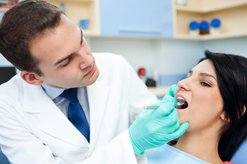 dentist is treating teeth of the patient