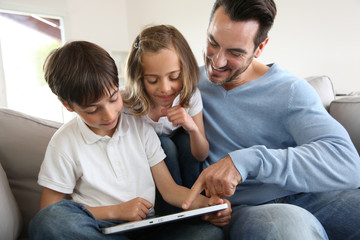 Family websurfing on internet with tablet