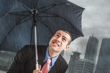 Businessman under heavy rain
