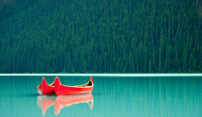 Aluminium Prints Canada Canoes floating peacufully on Lake Louise near Banff.