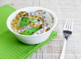 Plate and measuring meter, concept of weight loss.